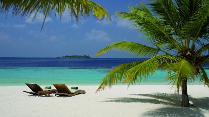 Stranden ved Coco Bodu Hithi på Maldiverne