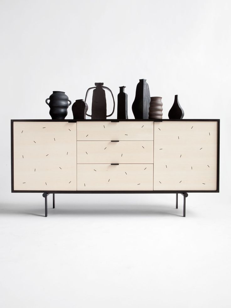 White Credenza + black art objects = contrasts