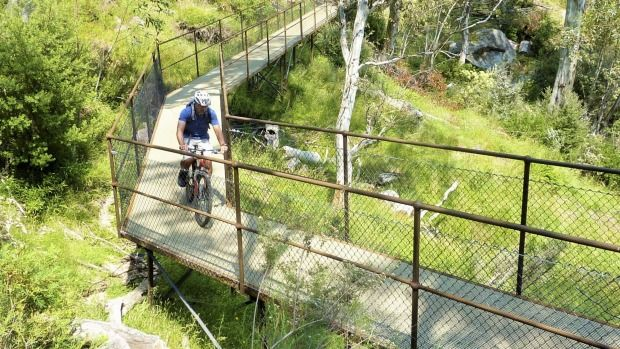 """From a """"crazy emu"""" to spectacular scenery, Tim the Yowie tackles the new multi-purpose Thredbo Valley Track on a bicycle."""