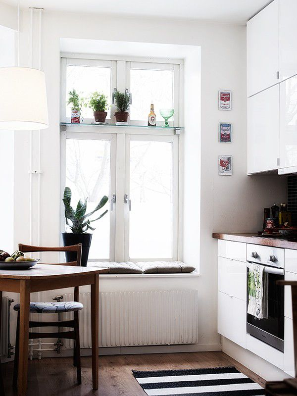 Wooden bench top + white cupboards + wooden floor + striped rug + CACTI :)