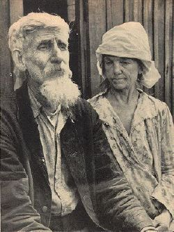 Hark Hatfield, 73, and his wife, who was Ollie McCoy, sit quietly in the sun