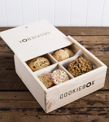 Port your famous homemade goodies in a box that's just as special as the contents inside. This cookie carrier is built of sturdy pine, with four partitioned segments and a sliding lid. Whether you're driving, biking, taking the bus or even just walking, this cookie box will keep your precious cookies safe, intact and from touching each other (if you bake several flavors at once, that is).