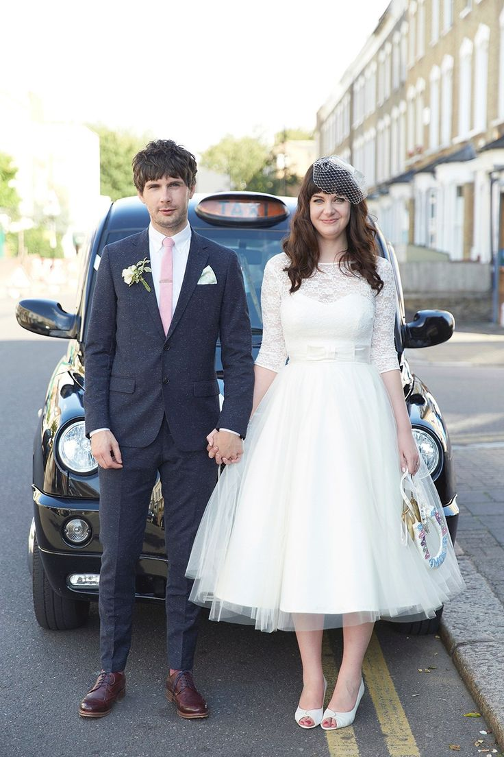 A 50's inspired tea-length dress for a pastel colour London pub wedding. Photography by Natalie J. Weddings.