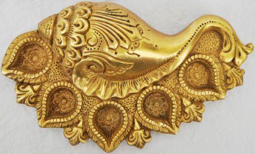 Beautifully carved Brass Oil lamp in Conch Shape Decorative Metal Arti Diya