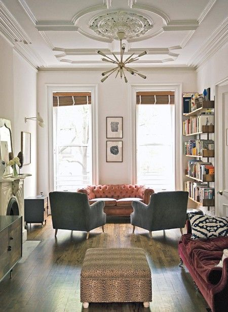 When faced with a large room, break your seating arrangements into several clusters. This will create separate sections in the room, making it more intimate and usable. Don't try to balance everything off the fireplace or windows.