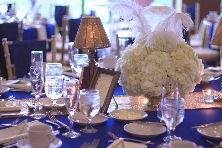 Gatsby inspired centerpiece for Anna and Monzeil at White Clay Creek Country Club.