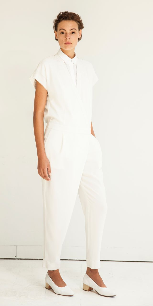 A chic jumpsuit will never do you wrong.  This beauty features a v-neckline with short sleeves, side pockets, and a crossover front detail.  Keep the look simple with some neutral hued lace-up flats and a bevy of bangles!