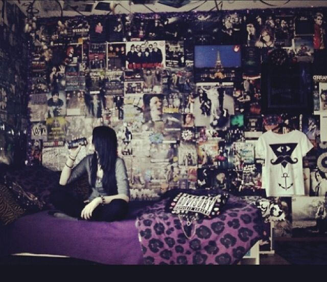 Walls covered in band posters