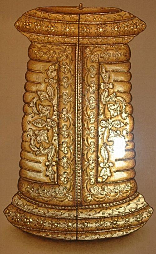 Ornate bracelet made out of 24 carat gold leaf