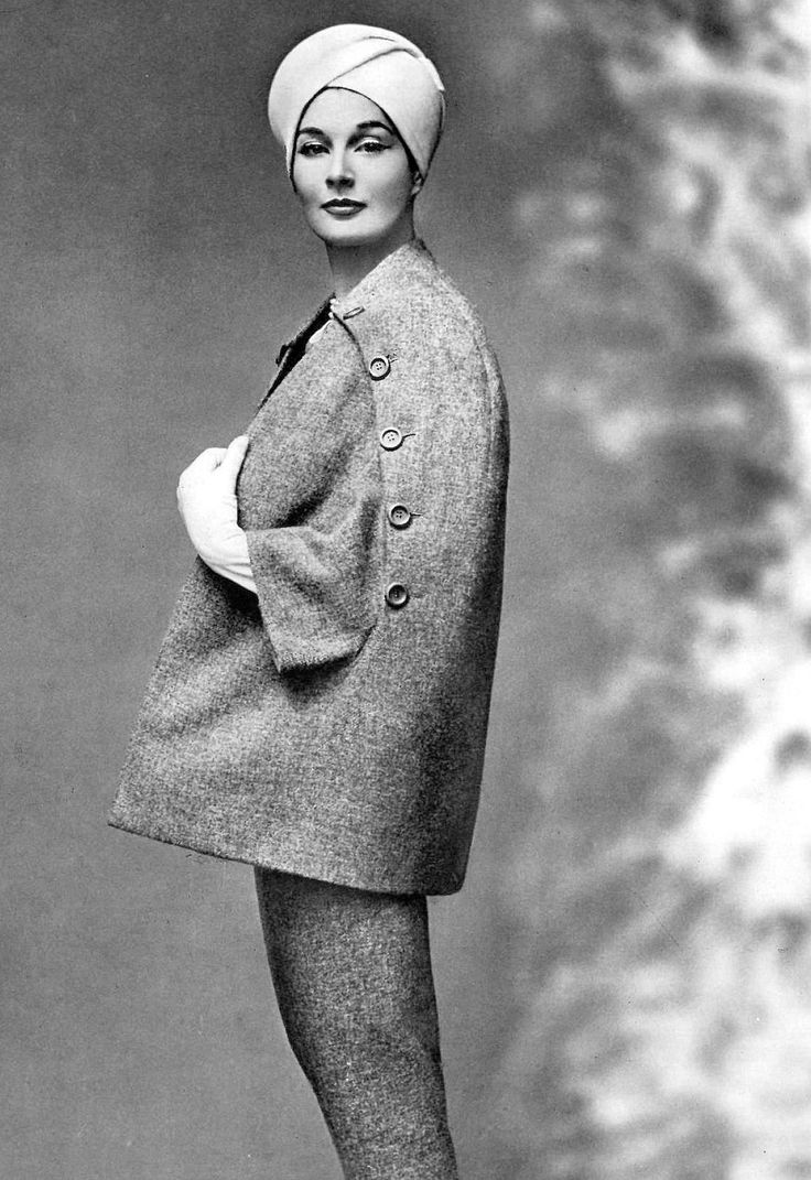 Bronwen Pugh (Lady Astor) in gray wool oval shaped cape over slim skirt by Pierre Balmain, photo by Georges Saad, 1957