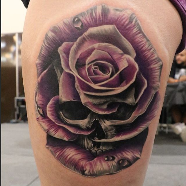 Skull to rose tattoo. I like this because the skull is quite subtle but it still gives the tattoo a gothic quality.