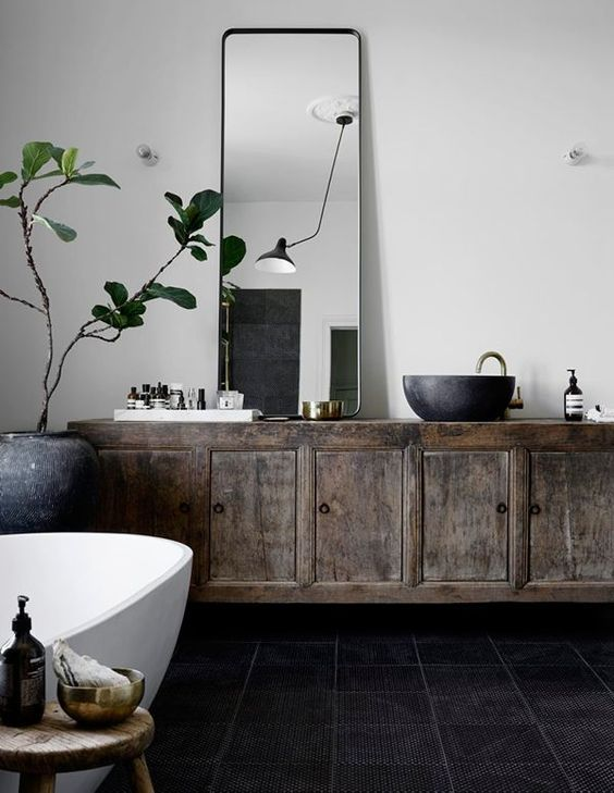 Inspiration Web Design vintage old cabinet has been repurposed as a vanity vessel stone sink and mid century black cone lamp gives a european spa feel to this bathroom