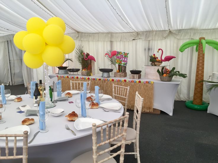 Bright yellow balloons for Hawaiian theme party