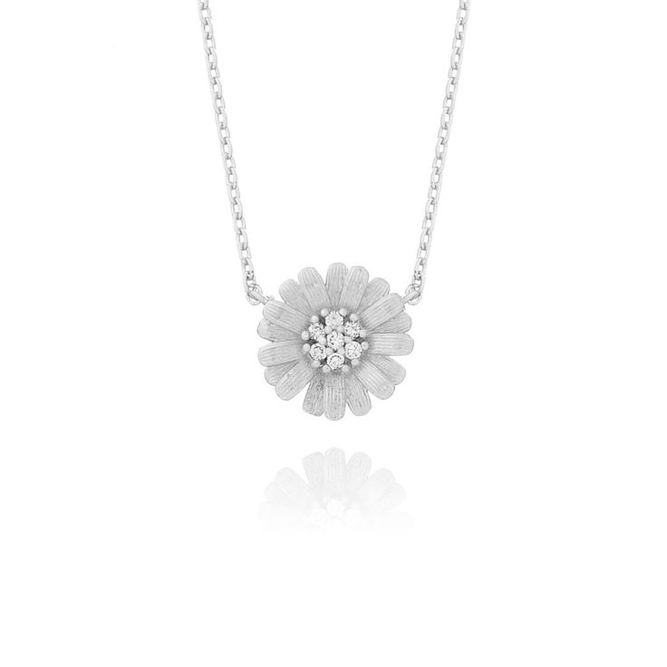 Cute daisy pendant, with cubic zirconia stones as the nectar. This beautiful piece is perfect as a layering necklace with other fine chains.  Chain length: 45cm  Top Pendant size: 1cm Diameter  Material: Rhodium plating over brass (Nickel & Lead free)  Stones: Cubic Zirconia Stones
