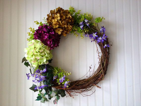 Aprox 20 across and 5 deep, this is a very stunning wreath in purple, light green and olive green hydrangeas. Purple wildflowers, eucalyptus