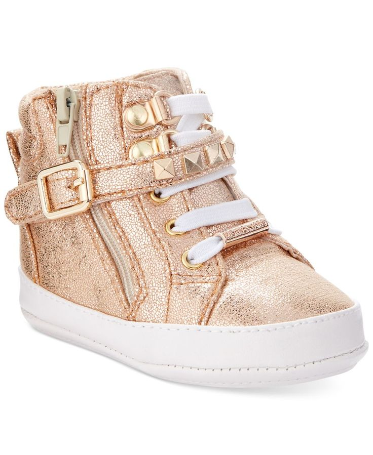 This babies' sneaker by Michael Kors is the perfect first-shoe for your tot. A belt closure and studded details will give her some style to look back on.   Synthetic upper; Rubber sole   Imported   La