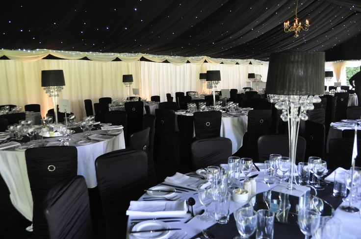 A 50th Birthday Party marquee, decked out with star cloth linings & black carpet