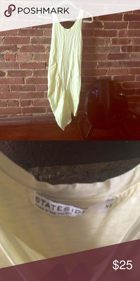 Light Yellow Dress with Sheer Side Detail Purchased from Revolve July 2015- worn once. Light yellow dress with a sheer side panel- amazing as a bathing suit cover up or with heels can be dressed up Stateside Dresses Midi