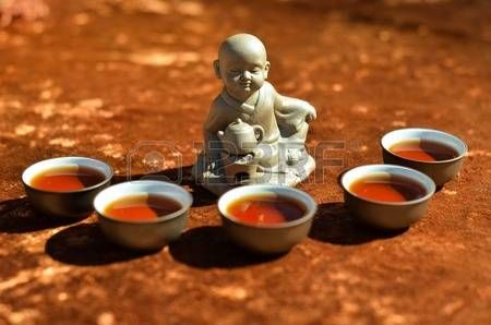 chinese thee: Chinese tea and boy figurine