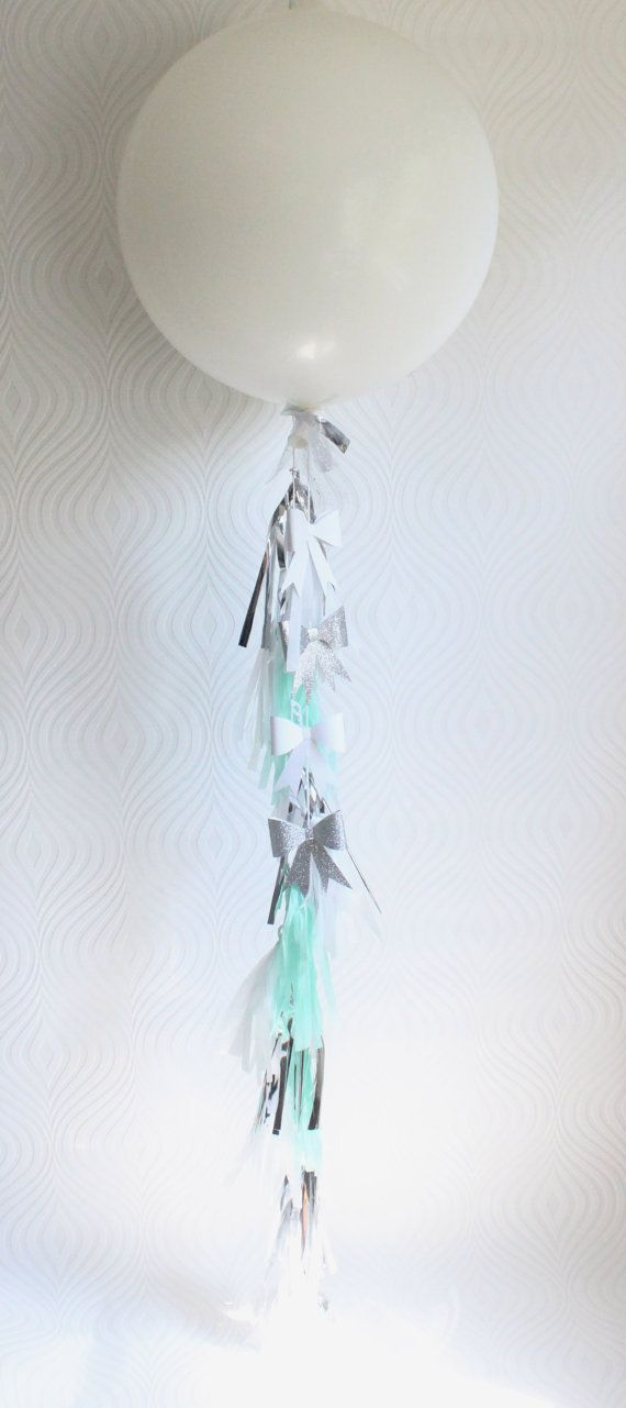 Mint + metallic tassel balloon + glittered bows. $20