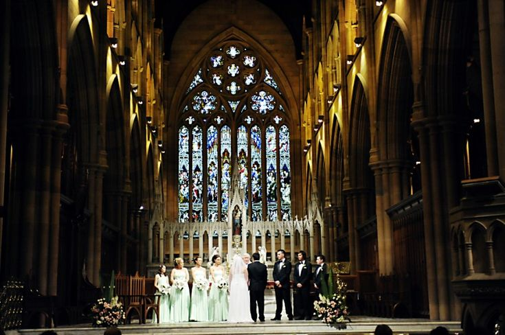 Leesa & Ian's wedding ceremony was held at St Mary's Cathedral which was spectacular. All the interior lights were on and it was a breathtaking sight. The couple was dwarfed on the altar amongst the sheer size and depth St Mary's. Wedding photography by Impact Images #centralcoastwedding