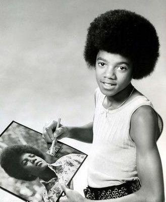 Michael Jackson hold a Ben album.