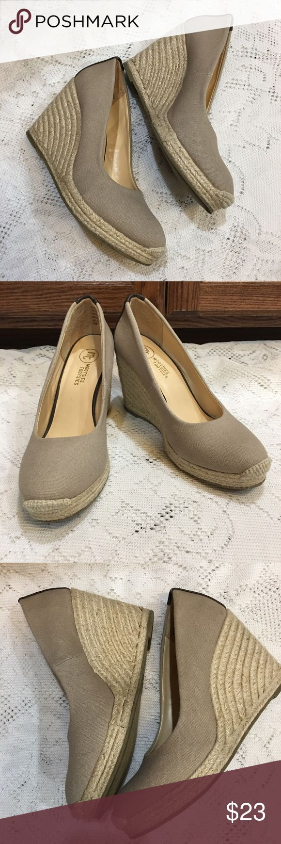 """Mootsies Tootsies wedge espadrille shoes. Sz 8.5🍷 Mootsies Tootsies wedge espadrille ladies shoes in EUC. Taupe canvas with dark brown faux leather patch on backs. 4"""" heel with a 3/4"""" platform which gives you a walking heel of approx. 3 1/4"""". Size 8.5 but fit like an 8. Mootsies Tootsies Shoes Espadrilles"""