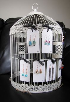 Birdcage to display jewelry at a craft fair. Could be used for other hanging products as well.