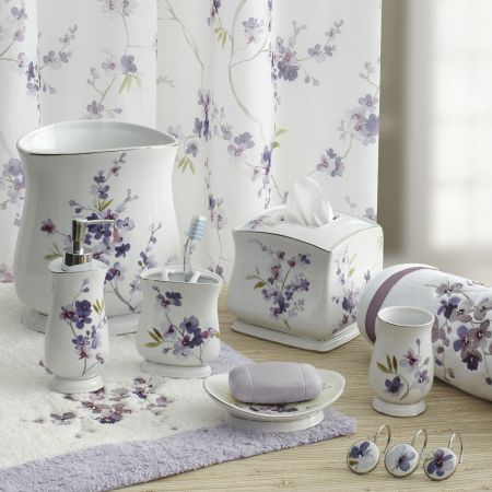 Delicate Purple Flowers Adorn A White Backdrop In This