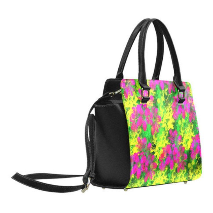 Pink tropical flowers on a green and yellow background make this print a bright and colourful must have handbag design. By Tracey Lee Art Designs