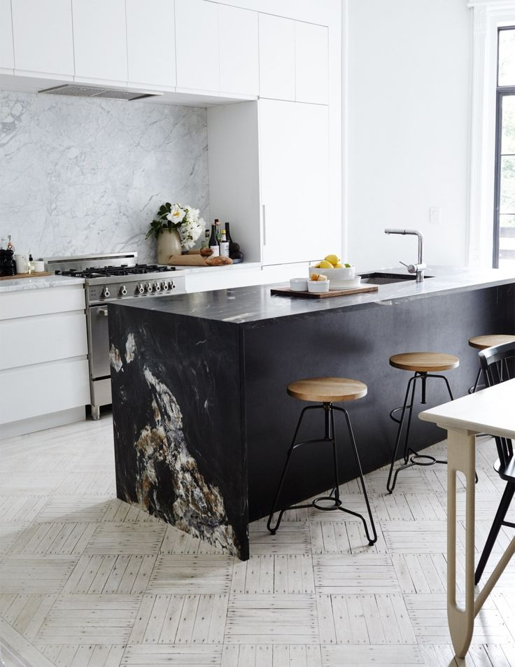 White marble has long been dominant in kitchens. If you're looking for something different, or want to embrace the trend of darker looks in the kitchen, consider black marble.