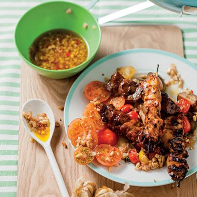 Taste Mag | Kebabs with tomato salad and roasted garlic and peanut dressing @ http://taste.co.za/recipes/kebabs-with-tomato-salad-and-roasted-garlic-and-peanut-dressing/