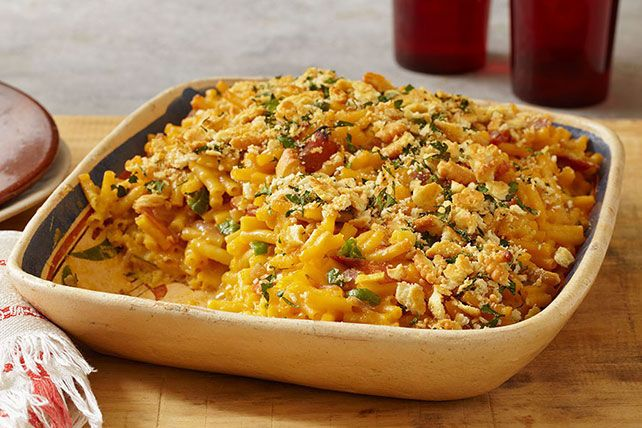Mac and cheese is the ultimate crowd-pleaser. This version will have the crowd on its feet and cheering. Turn up the heat with jalapeños and ham baked right in.