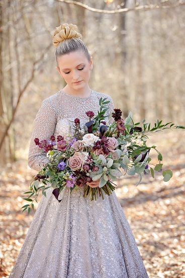 Romantic garden style bridal bouquet with plum, burgundy, mauve and blush blooms.