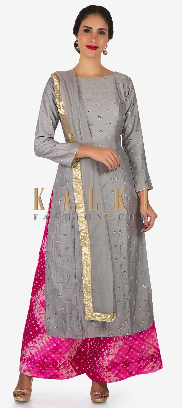 Buy Online from the link below. We ship worldwide (Free Shipping over US$100)  Click Anywhere to Tag Grey and rani pink palazzo suit beautified with sequin zari butti embroidery work only on Kalki Get your hands on this beautiful grey and rani pink palazzo suit to stand out in the mehendi ceremony. The suit in cotton silk is embellished in scattered sequin butti work all over. Matched with a rani pink palazzo flaunting the batik print with golden buttis. Set together with a grey dupatta in…