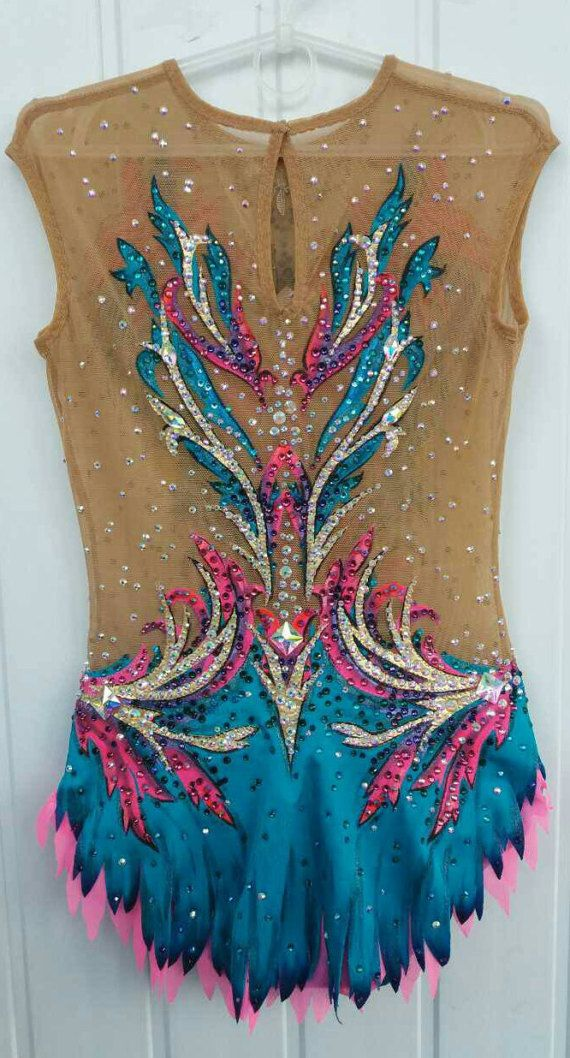 Beautiful designer rhythmic gymnastics leotard handmade,worn at ones for the rhythmic gymnastics competition. Design drawing on fabric acrylic paints.  The leotard for the rhythmic gymnastics competition made with over 3500 rhinestones very high quality.  If you have any quastions let us know please. You can order another size and color