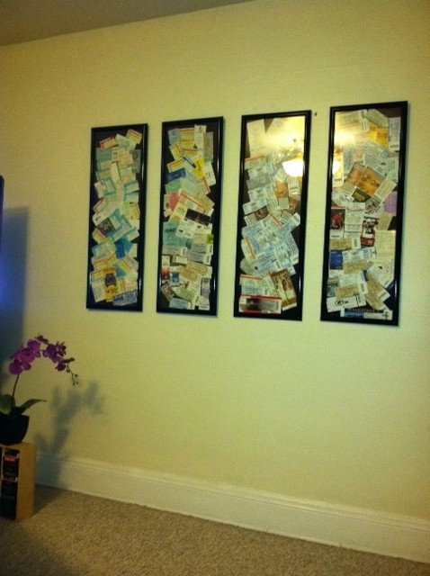 i save all of my tickets to events.  i love collages so i collaged them and framed them.  they're in chronological order.