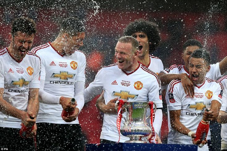 Rooney (centre) leads the celebrations as the champagne sprays after Manchester United's FA Cup final victory