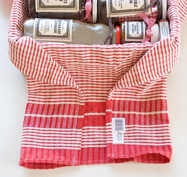 Use tea-towel as hamper liner for new home gifts.