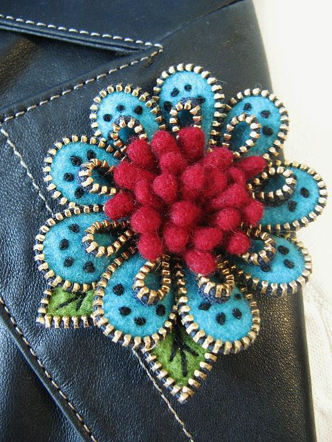 Zipper and wool floral pin...