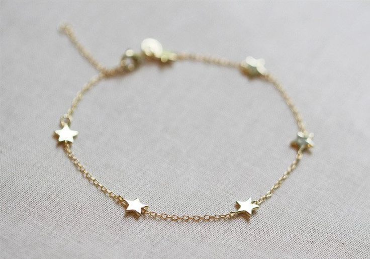 Six tiny little stars hang along delicate chain. Works great layered with other bracelets or all alone. Details: - 6 inches long with 2 inch extender - 14kt gold or rose filled or .925 sterling silver