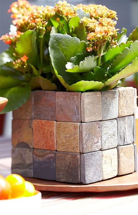 Stone tiles conceal an inexpensive metal can used as a planter.