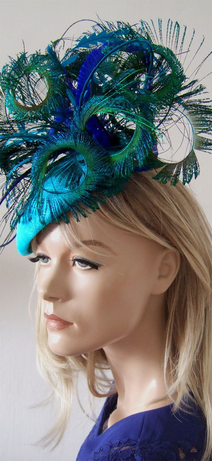 Brilliant Lagoon Turquoise, Royal Blue and Green Headpiece Peacock and Ostrich fascinator. Handmade in the UK. Can be customised to match your outfit colours. Perfect hat for the Races, Royal Ascot, Kentucky Derby, Melbourne Cup or any Races, Mother of the Bride or Friends wedding. #racingfashion #millinery #fashion #fashionista #peacocks #feathers #outfits #outfitinspiration #dress2impress #HatsForWomenRaces