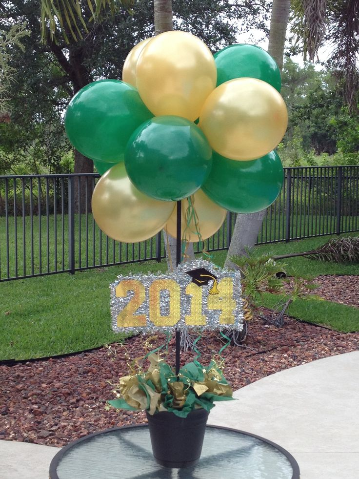 #graduation #greenandgold #centerpieces #decorations #balloons #balloon topiary.  Green and Gold school colors for BRCS.
