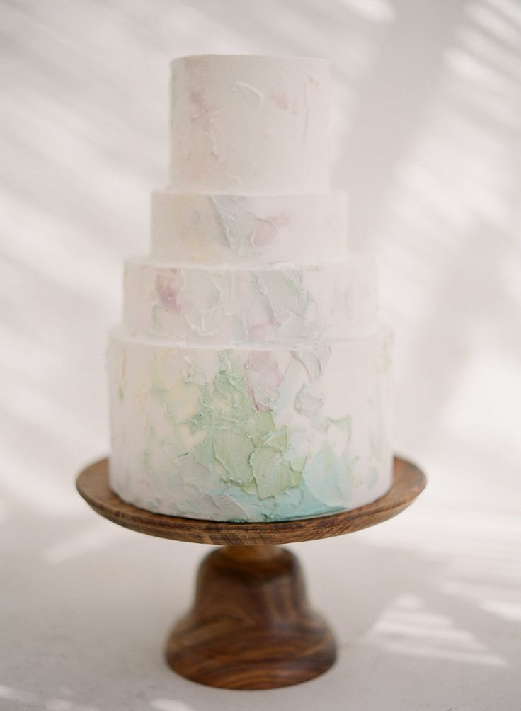 Stone effect simple 4 tier cake with gorgeous pastel colour details | Luxury Wedding in Santorini