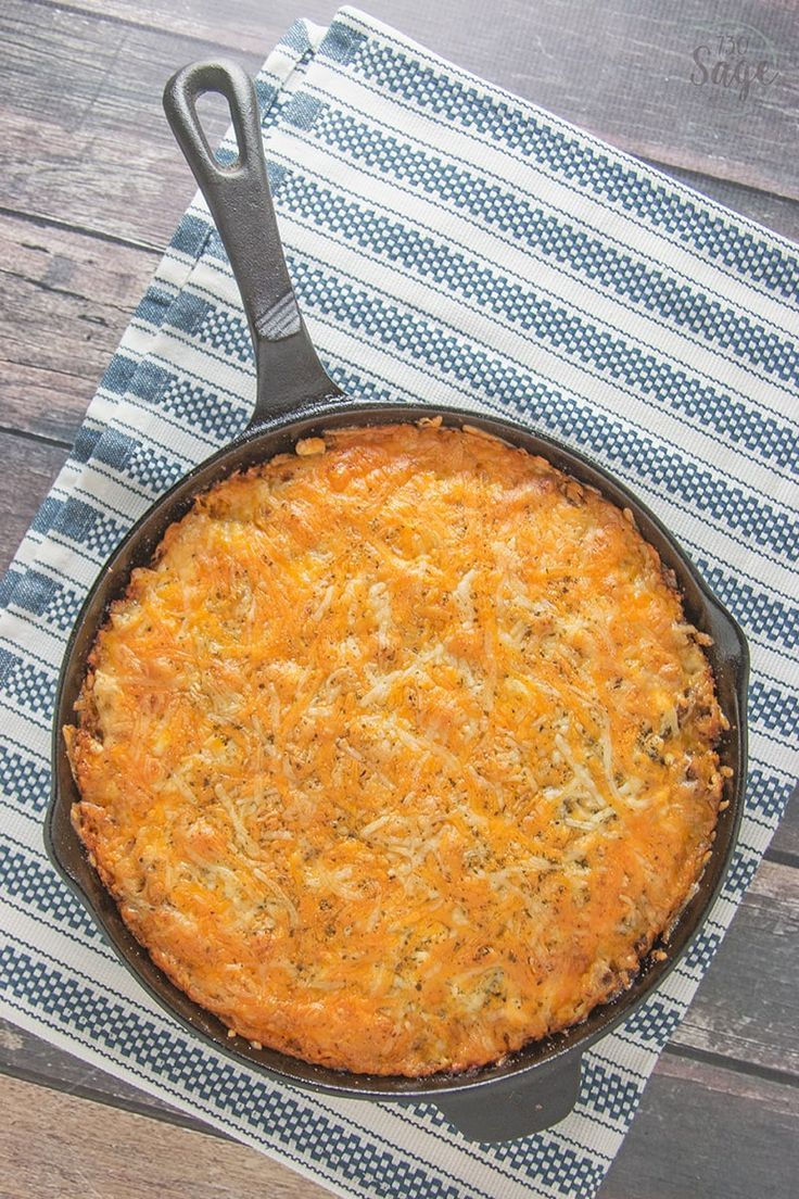 Easy low carb cheeseburger pie! Bake this in a skillet or casserole dish for a quick, delicious meal, the whole family will enjoy. #lowcarb #keto