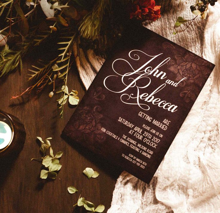 Custom designed invitation in black with soft lace background - this design was continued throughout all the design elements; menus, place name cards & signage.