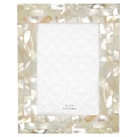 """Highlight beloved memories and artful sketches with this chic picture frame, perfect for bookcase, mantel, or writing desk.Product: Picture frameConstruction Material: Mother of pearl  Color: Cream  Features: Holds one 4"""" x 6"""" photoDimensions: 8"""" H x 6"""" W x 0.5"""" D"""