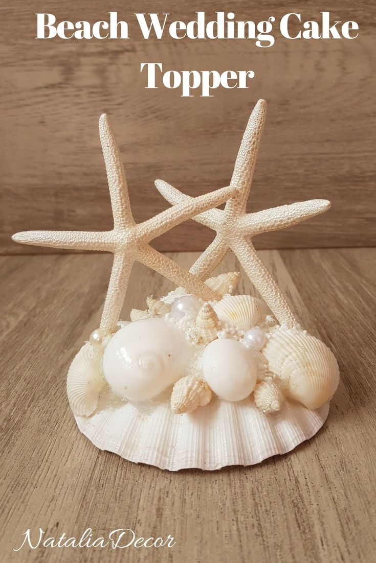 Perfect for your beach theme wedding ! This cake topper features scallop shell in base, 2 natural white Starfish , real shells and beads. Beach Theme Wedding Cake, Topper Seaside, Shell wedding decor, Seashell Starfish Topper, Nautical Destination Coastal Wedding Topper, White Cake Top #beachcaketopper #weddingcaketopper #beachweddingtopper #nauticalwedding #weddingcake
