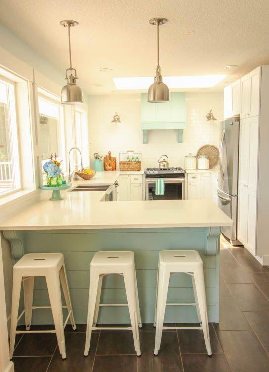 Gorgeous Coastal style white shaker kitchen with aqua blue at thehappyhousie.com